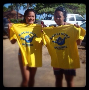 """Proudly displaying the t-shirts we earned from our """"grueling"""" surf lesson"""